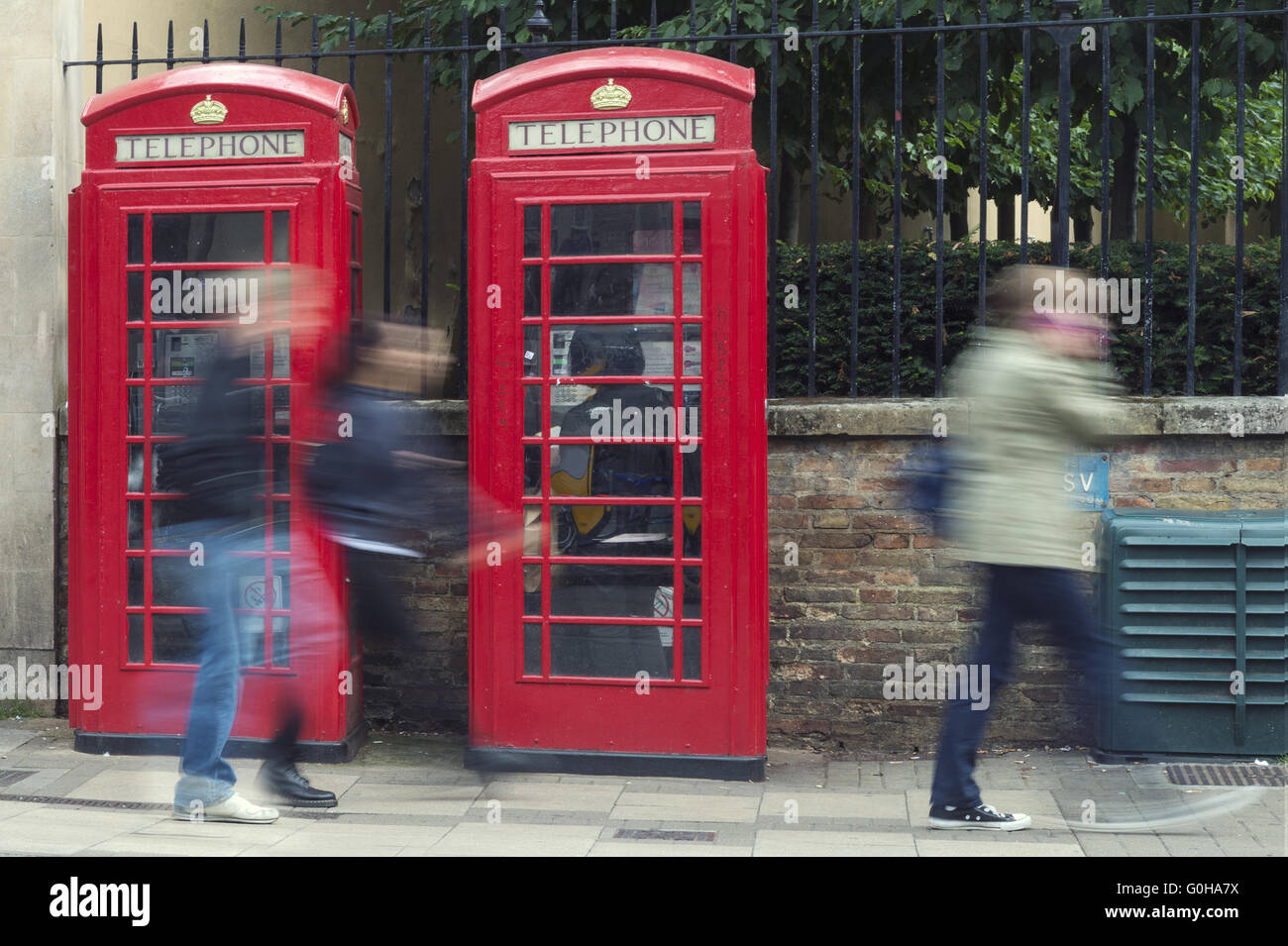Schemes of passers 2 red phone booths. Stock Photo