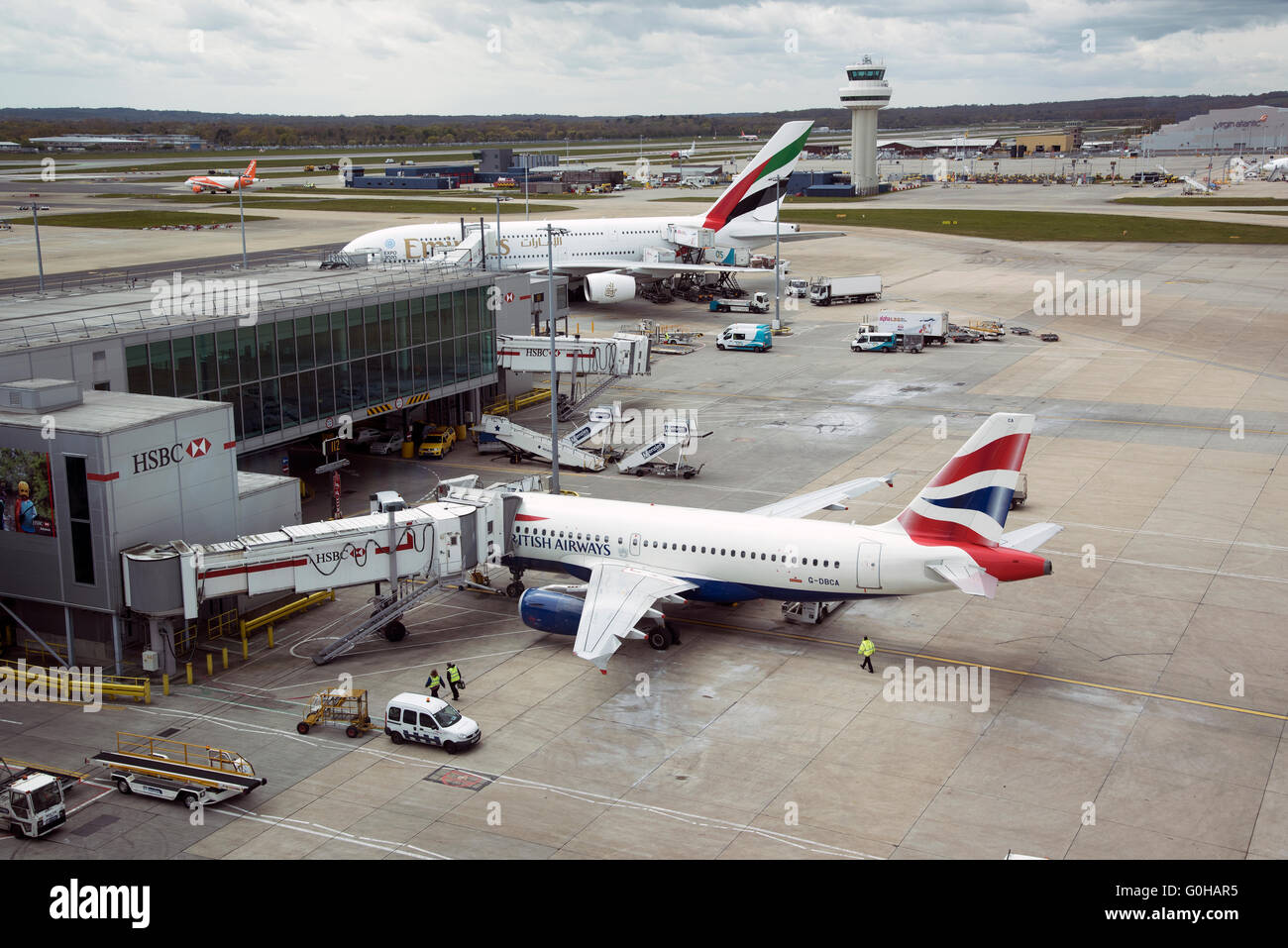 London Gatwick Airport with passenger jets on the jetway - Stock Image