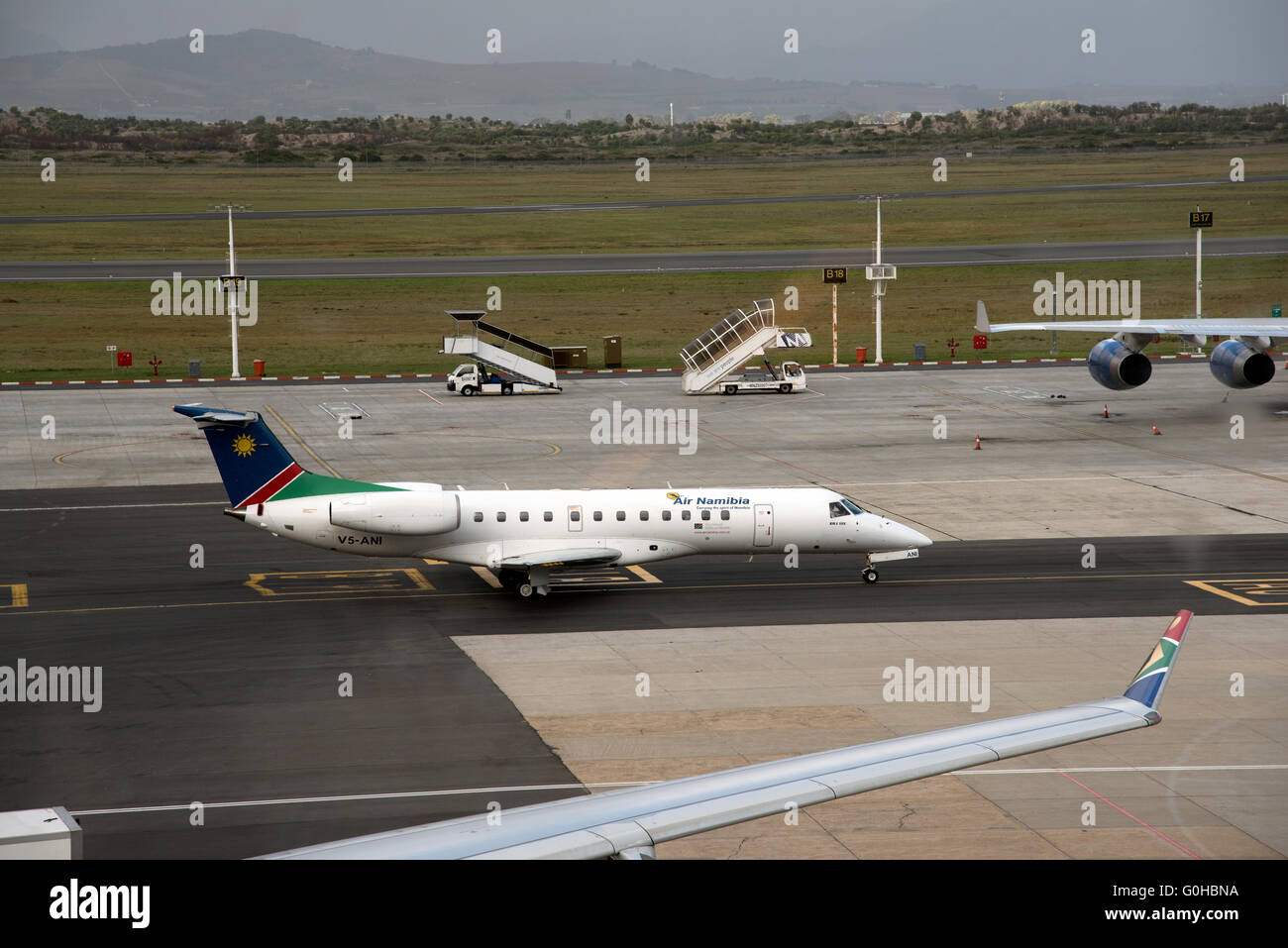 CAPE TOWN INTERNATIONAL AIRPORT SOUTH  AFRICA  An Air Namibian Embraer ERJ 135 jet on taxiway - Stock Image
