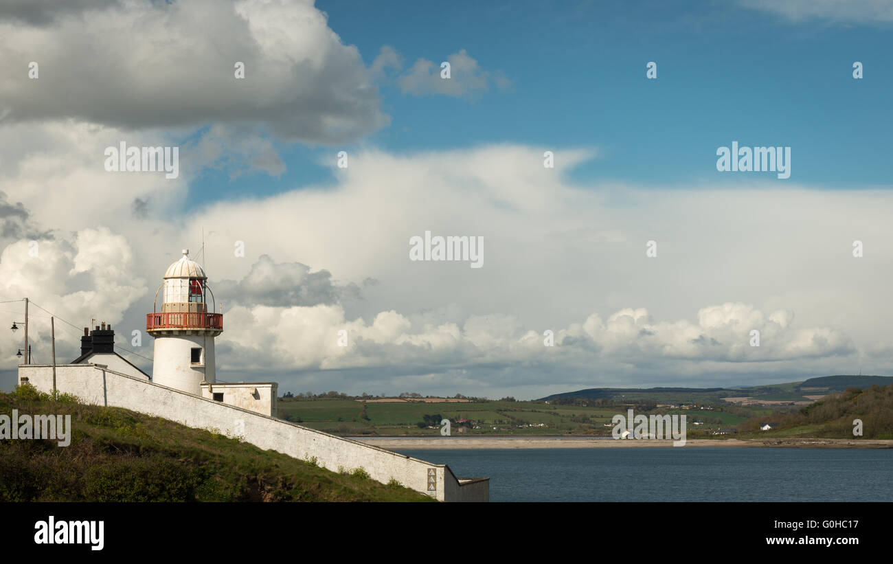 Youghal lighthouse against blue skies with white clouds Stock Photo