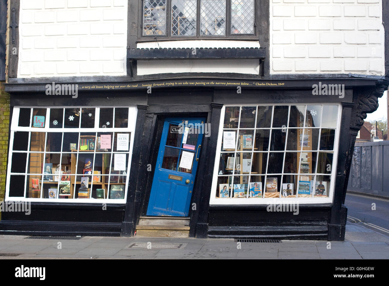 Old King's School shop with crooked blue door - Stock Image