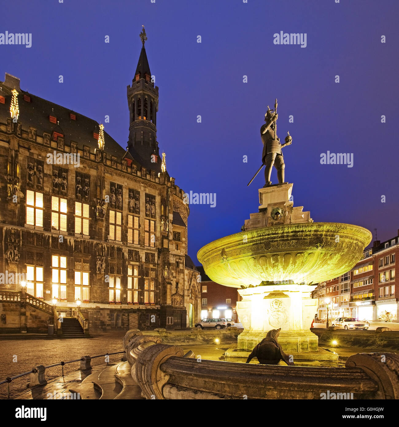 Charlemagne fountain in front of the town hall in the evening, Aix-la-chapelle, Germany, Europe - Stock Image