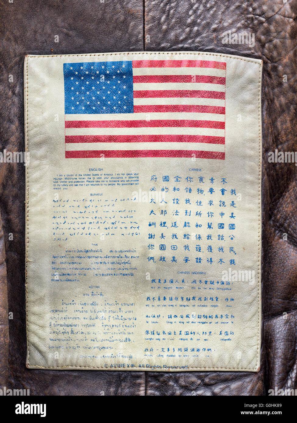 Wording on back of US USAF bomber jacket. Many languages inc Thai, Burmese, Chinese. - Stock Image