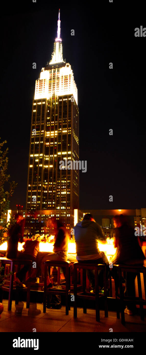 Rooftop bar looking onto the Empire State Building, NYC,USA - Stock Image