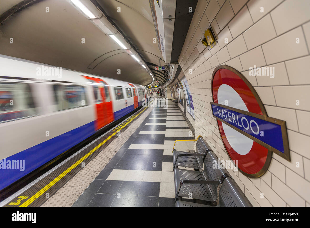 Waterloo Underground station in London, UK, as a train is arriving - Stock Image
