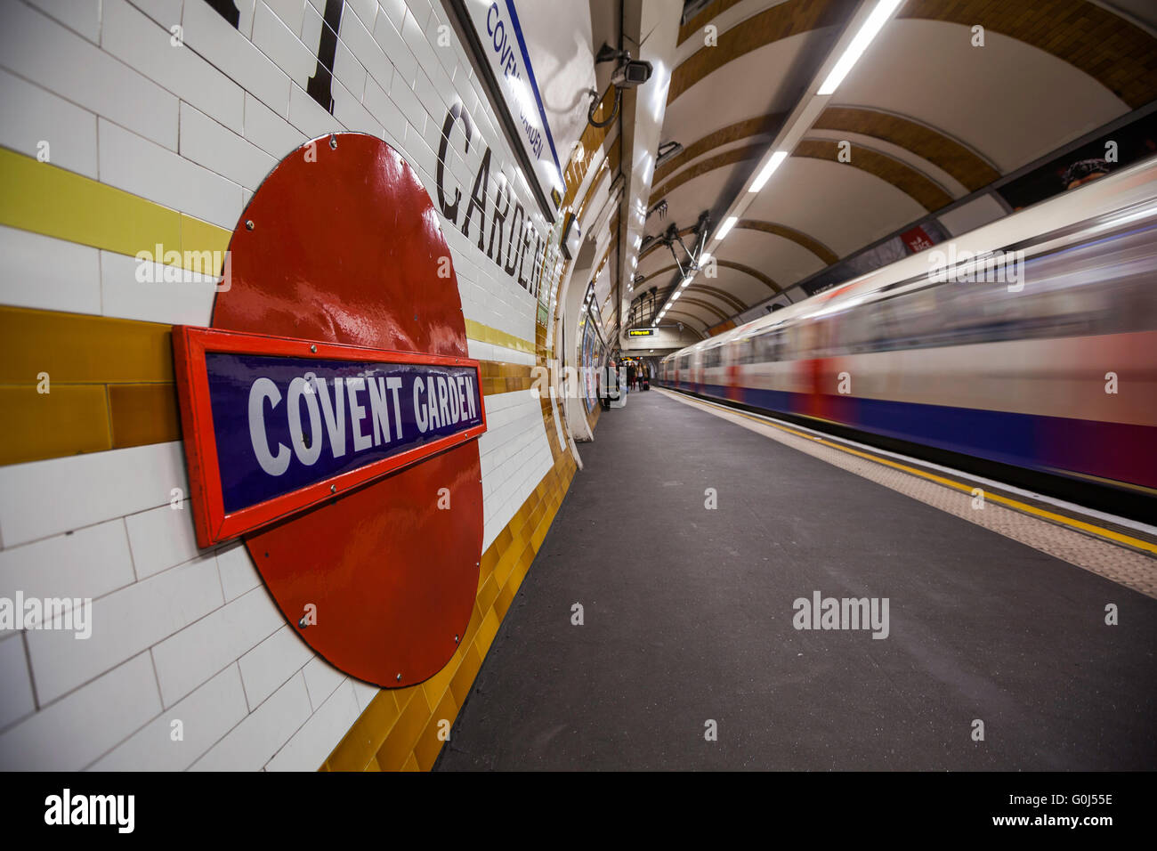 Covent Garden underground Station, London, UK, shot while a train is leaving the station - Stock Image