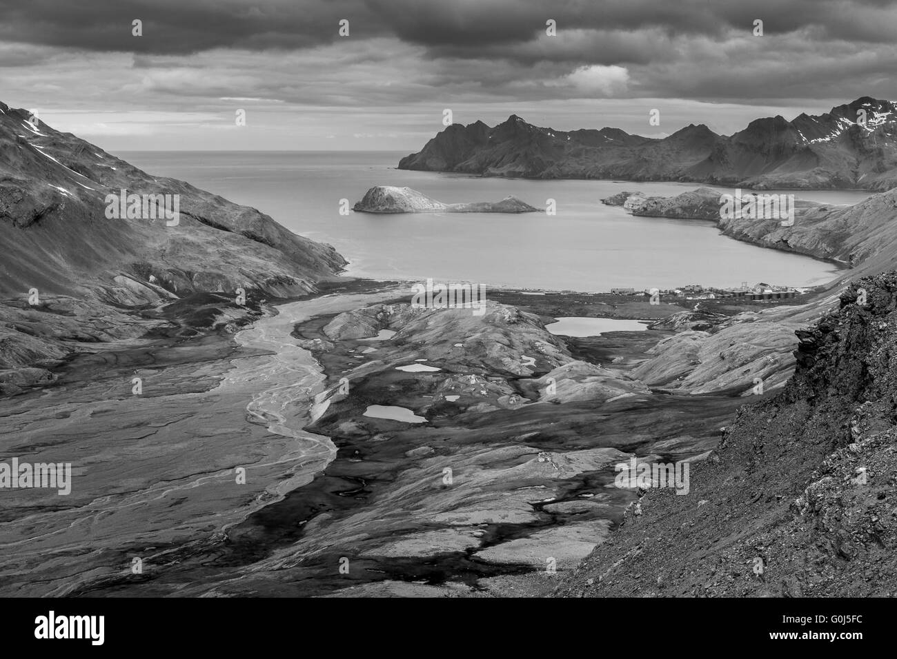 Landscape view of alluvial valley and Stromness whaling station, South Georgia in December 2013. - Stock Image