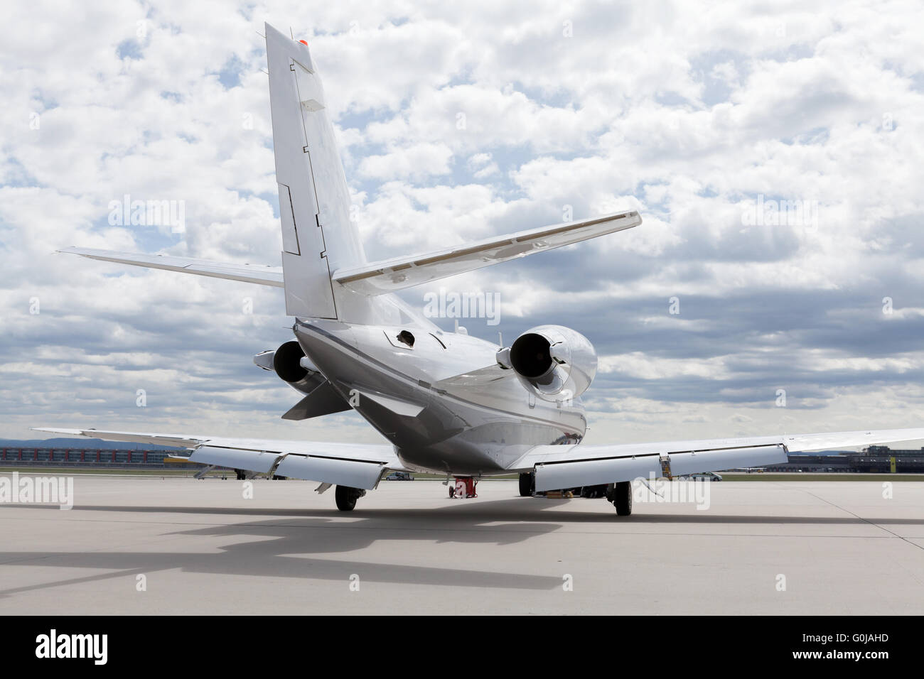 Aircraft Plane in front of the Airport with cloudy sky - Stock Image