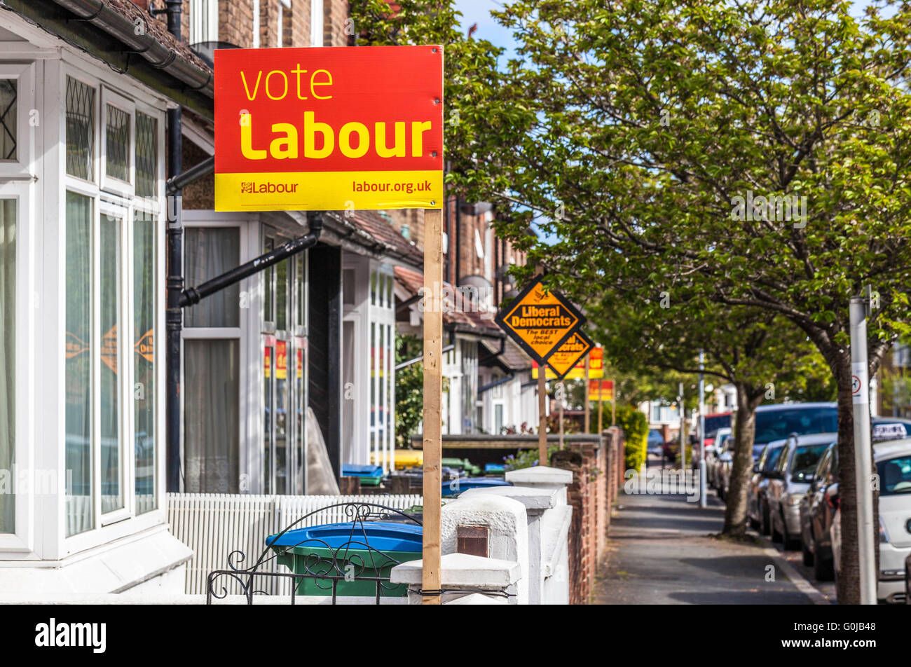 Row of terraced houses displaying political parties pole signs in election period, Watford, Hertfordshire, England, - Stock Image