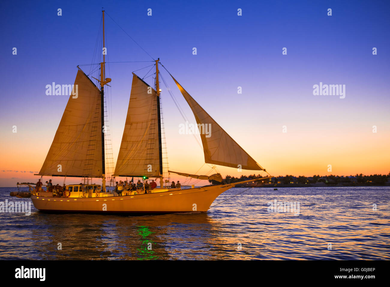 Beautiful sailboat at sunset seen from Key West Florida - Stock Image