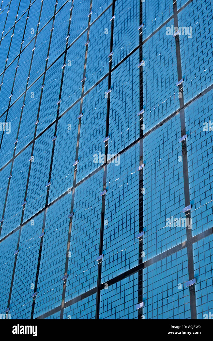Detail of a structure of blue glass panels on the facade of a contemporary building - Stock Image