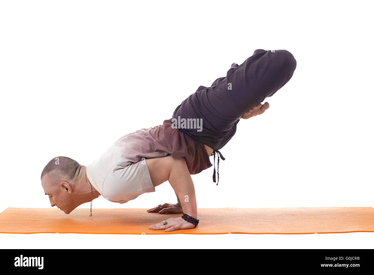 Focused Athletic Man Posing In Difficult Yoga Pose
