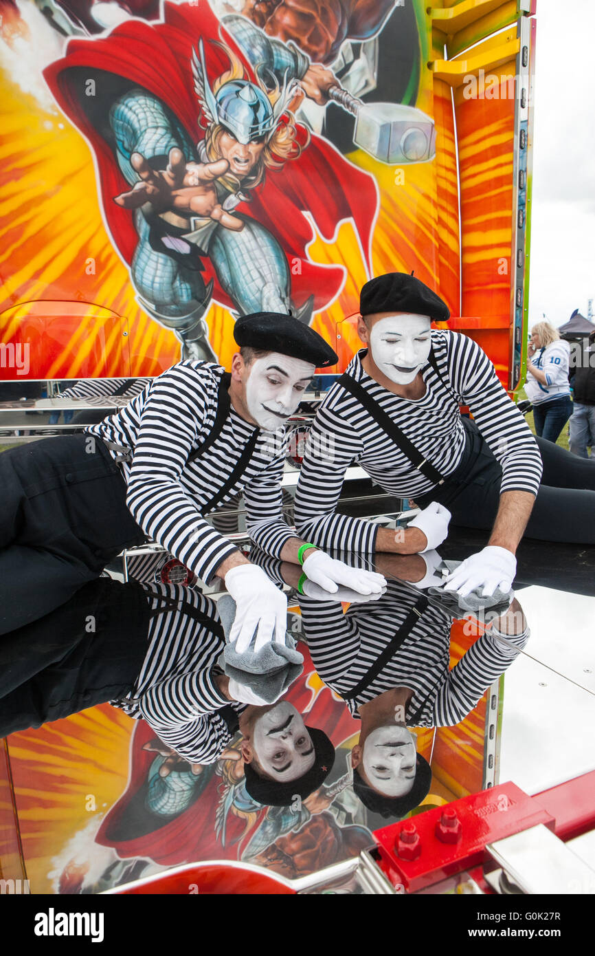 Mime Artists entertain at Truckfest 2016 by polishing a state of the art Scania truck - Stock Image