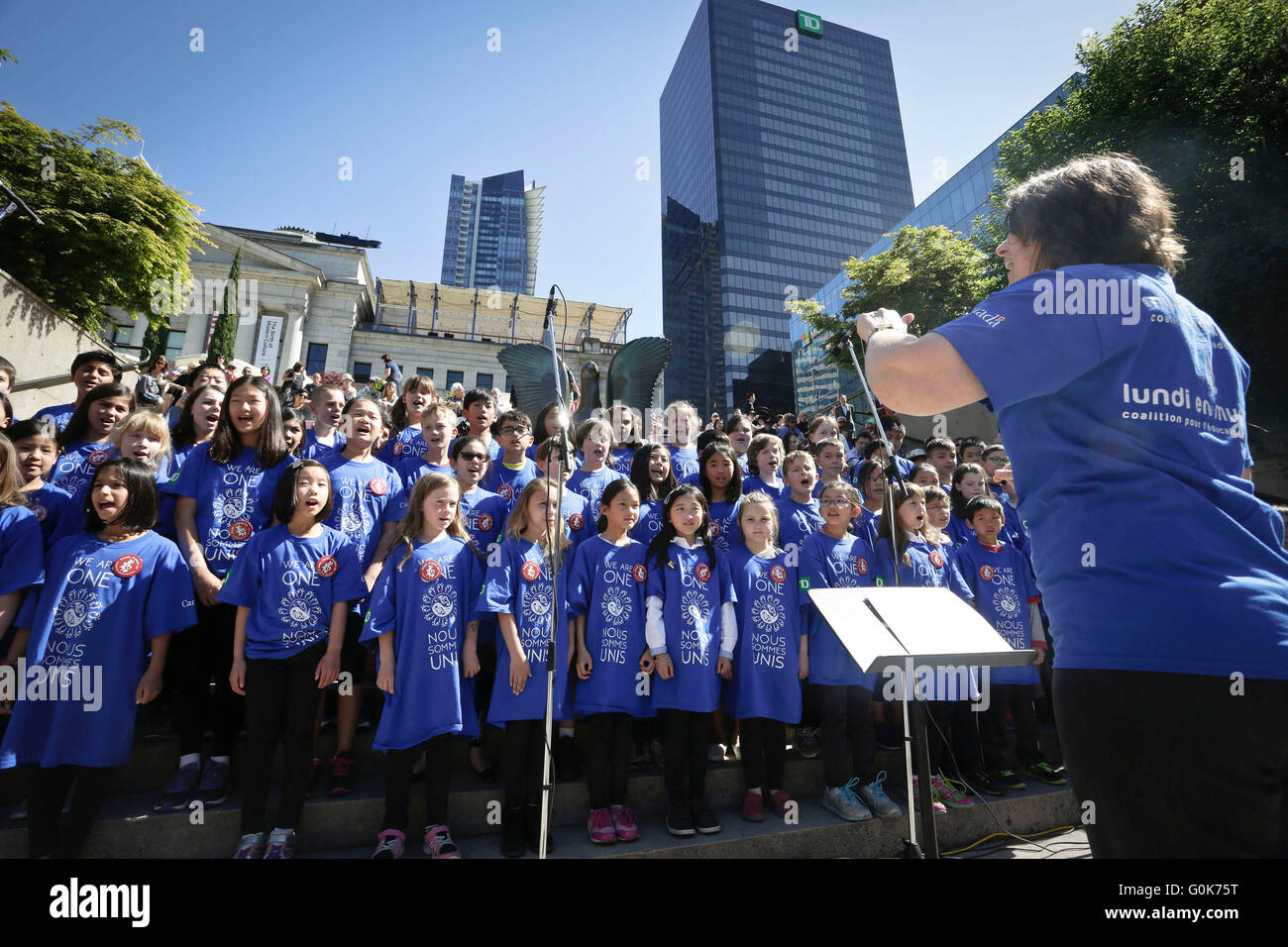 Vancouver, Canada. 2nd May, 2016. Student choirs perform during the 'Music Monday' event at Robson Square - Stock Image