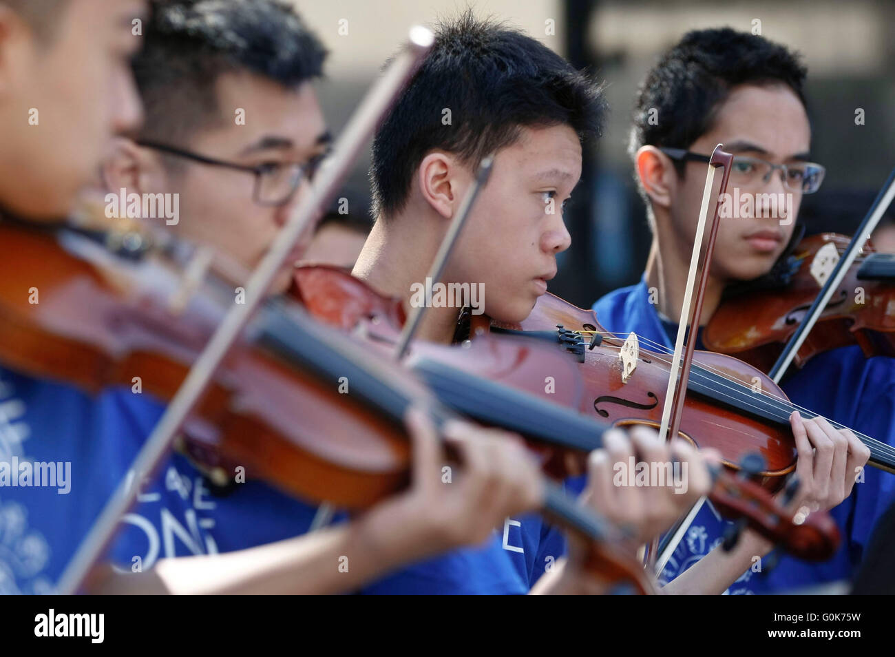 Vancouver, Canada. 2nd May, 2016. Students from school band perform during the 'Music Monday' event at Robson - Stock Image