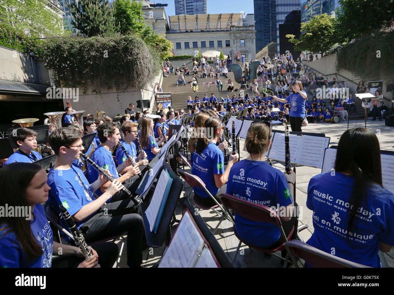Vancouver, Canada. 2nd May, 2016. Members of a student band perform during the 'Music Monday' event at Robson - Stock Image