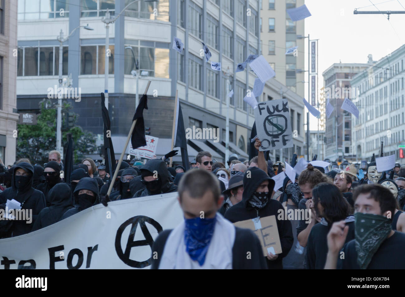 Seattle,USA. 1st May, 2016. Anarchists and Anti-Capitalism/Police force activists march in downtown. - Stock Image