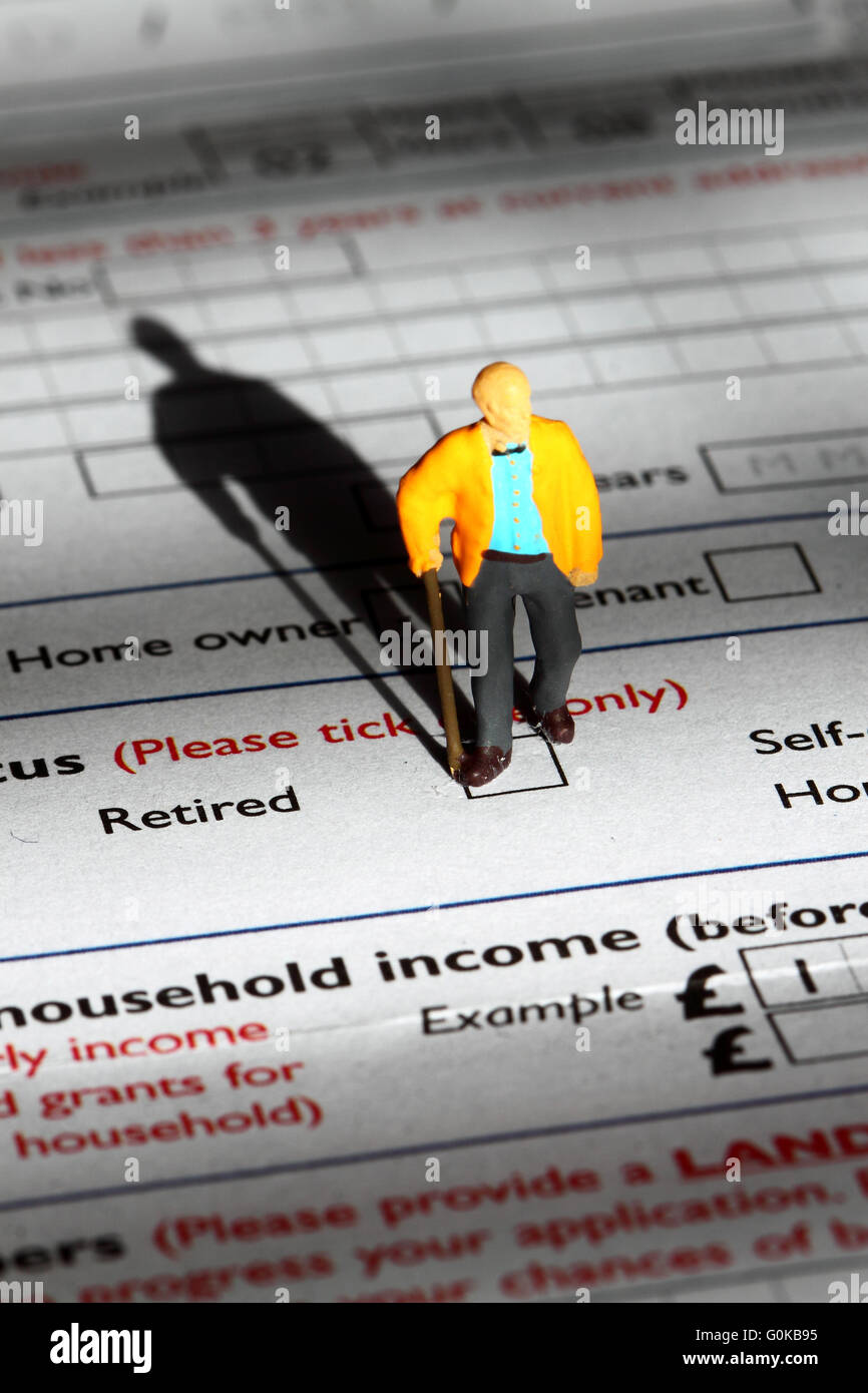 Miniature model pensioner standing on an application form Stock Photo