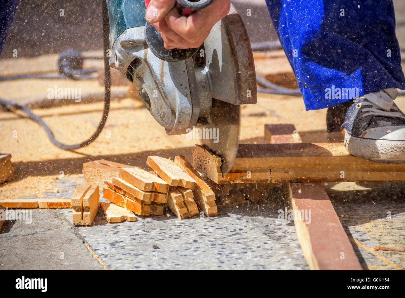 Carpenter Using An Electric Saw Cutting Small Wooden Figures