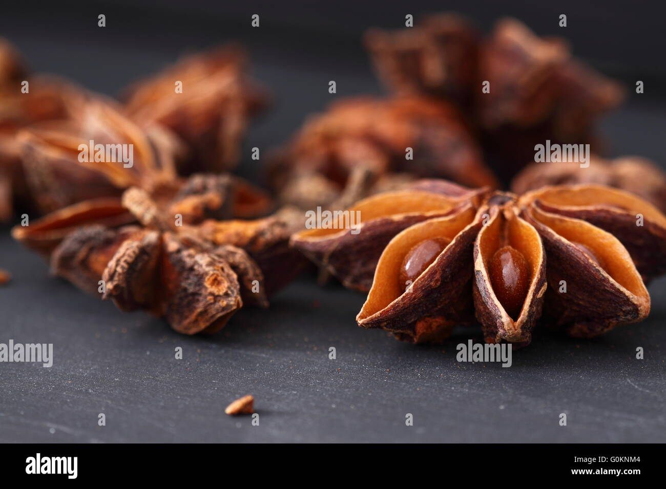 Star Anise on a black wood background - Stock Image