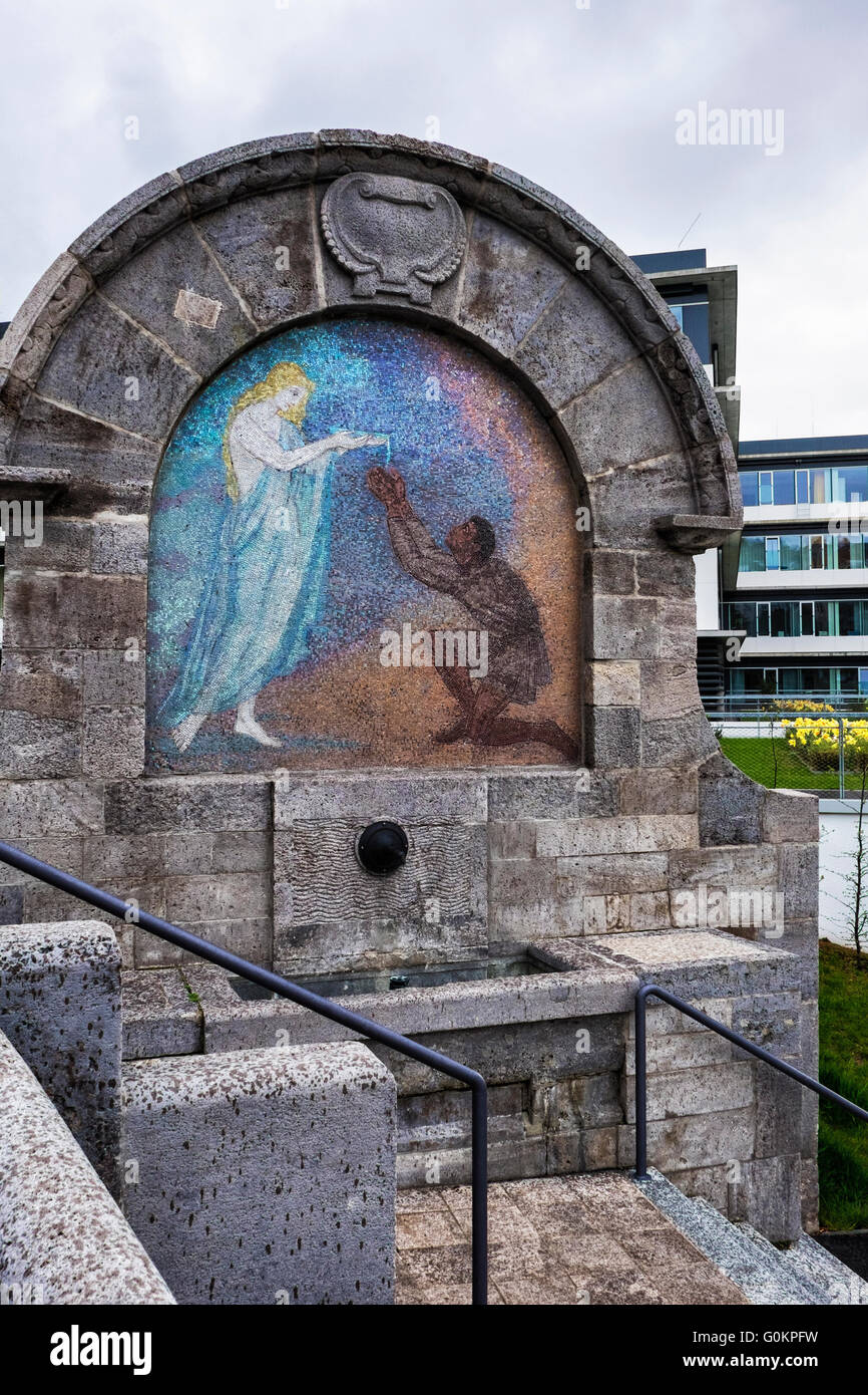Old Mosiac water fountain with religious motif outside modern hospital, Stuttgart Klinikum, Germany - Stock Image