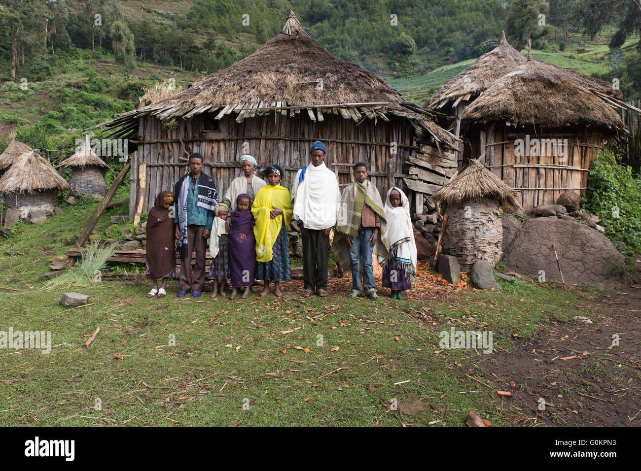 Wofwasha,  Ethiopia, 2013:   Hailemariam Woldoyohanus, 37, and his wife Zenobich  and the extended family group. - Stock Image