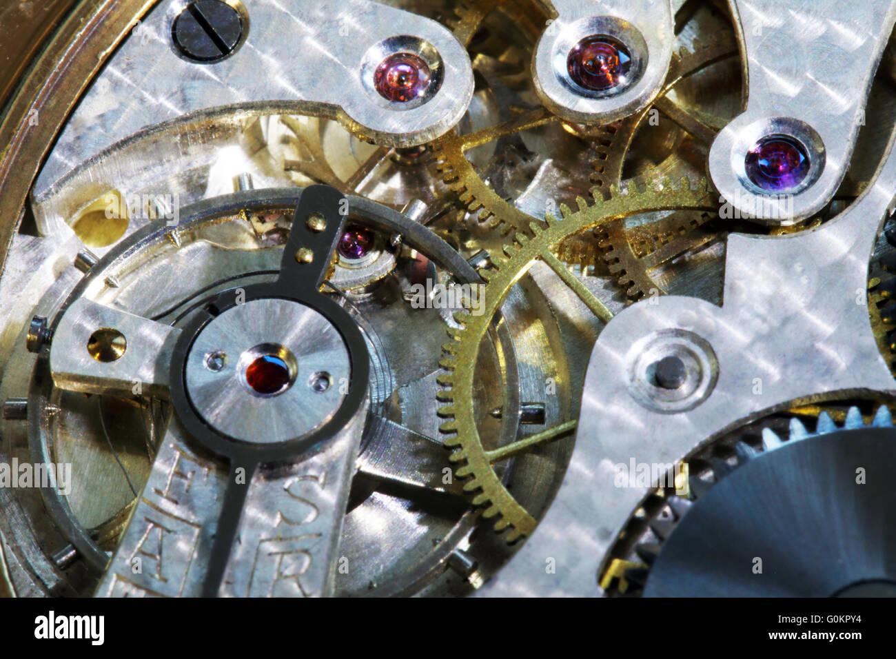 Inner workings of a vintage pocket watch - Stock Image