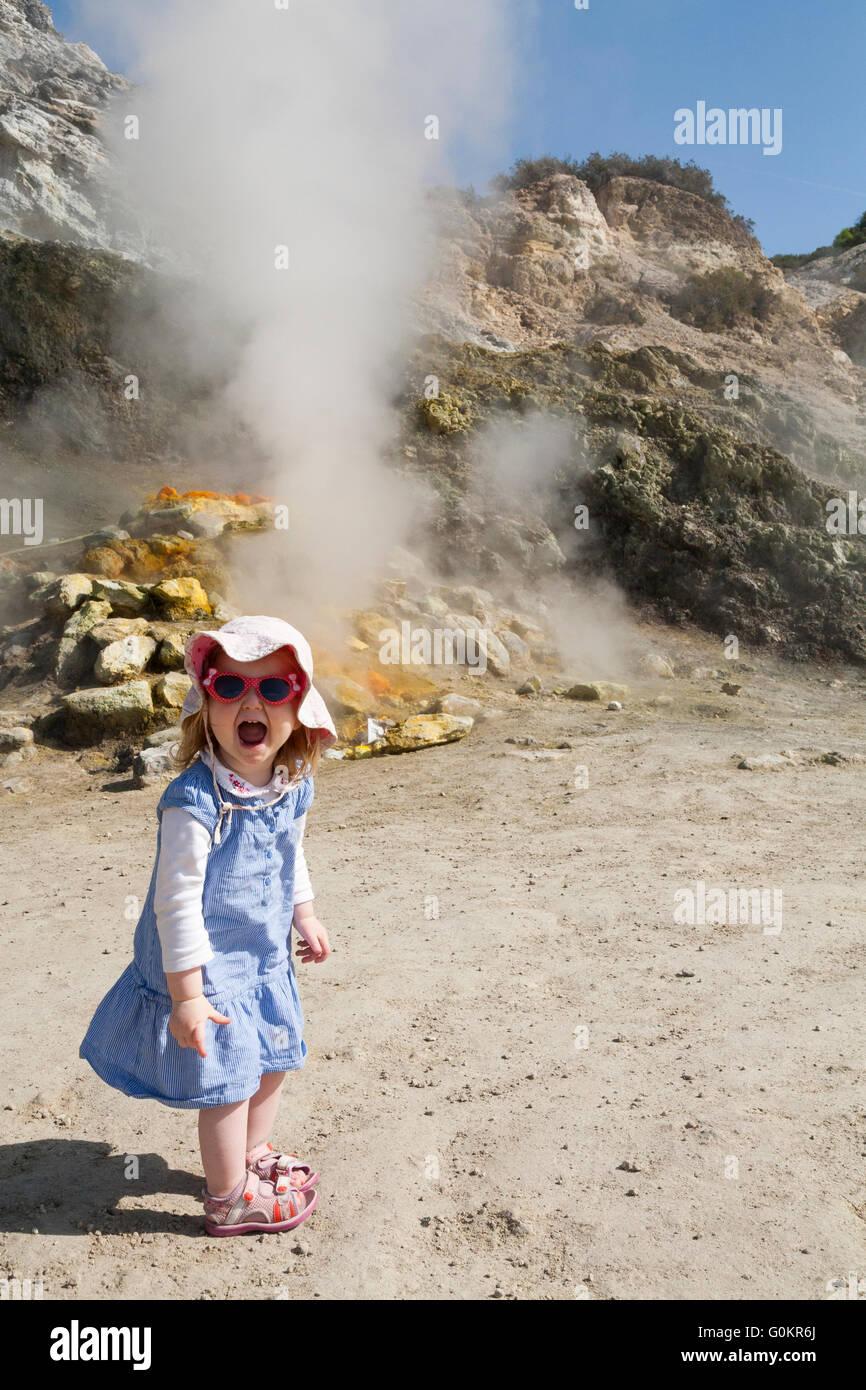Tourist toddler / child / kid at Solfatara volcano steam & sulfurous fumes Pozzuoli, Naples Italy; Campi Flegrei - Stock Image