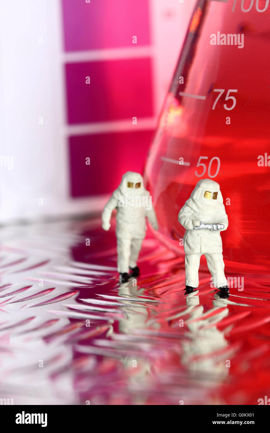 Hazardous chemical team with a laboratory glass flask - Stock Image