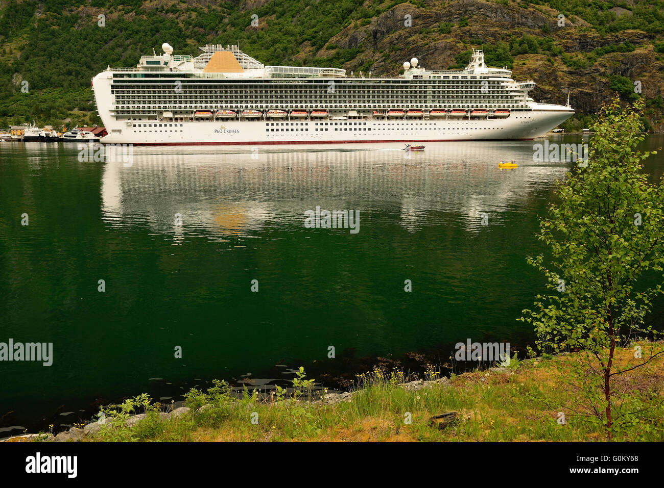 P&O cruise ship Azura berthed at Flam on the Aurlandsfjorden, a branch of the Sognefjord, which is Norway's - Stock Image