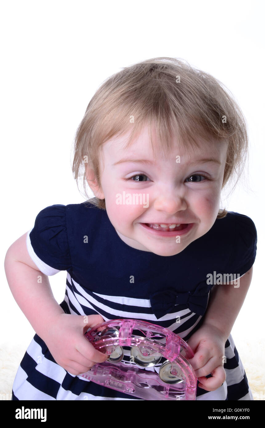 crazy little girl excited and playing - Stock Image