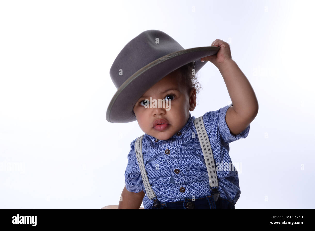 mixed race young boy with big hat, vintage Jamaican style, windrush generation Stock Photo