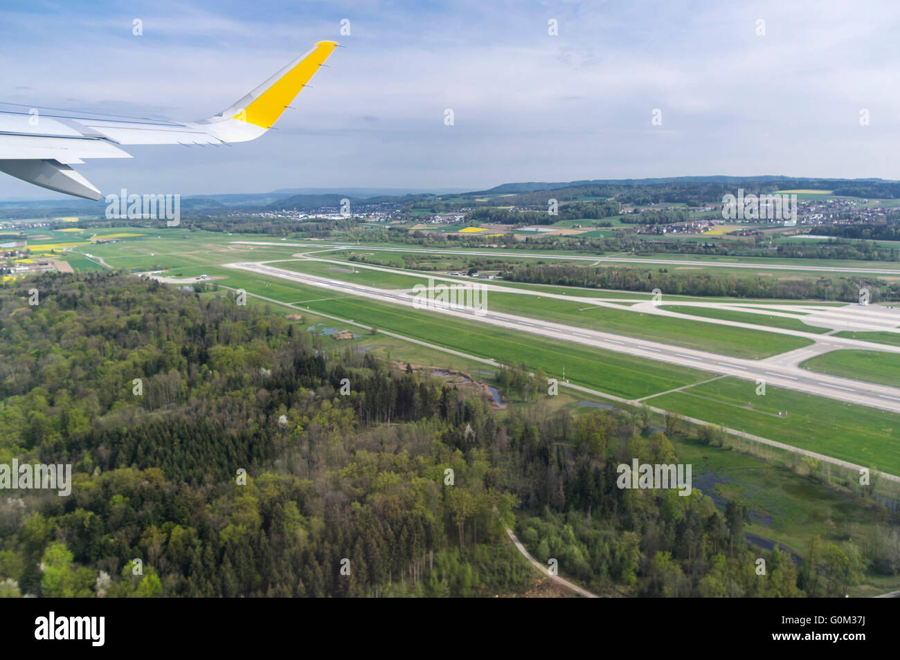 Aerial photography of a runway of Zurich airport out of a Vueling airplane just after take-off. - Stock Image