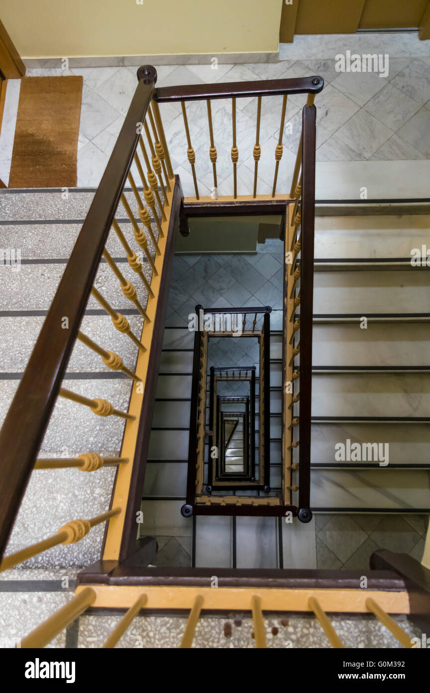 Looking down several flights of stairs from the top floor. - Stock Image