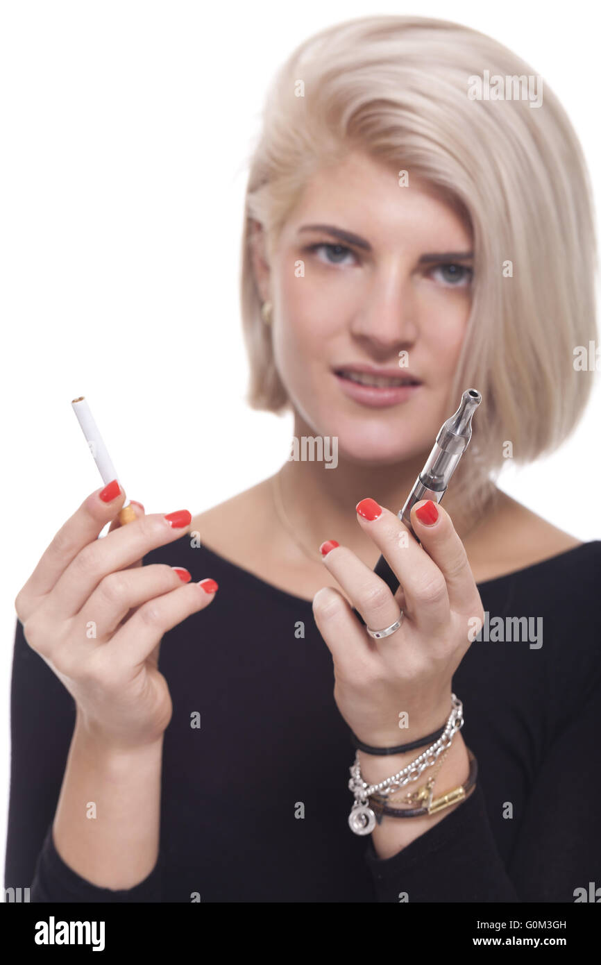 Blond Woman Holding a Tobacco and E-Cigarette - Stock Image