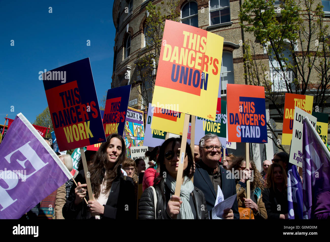 Mayday 2016. Clerkenwell. International workers Day. Dancers Union members with placards. - Stock Image