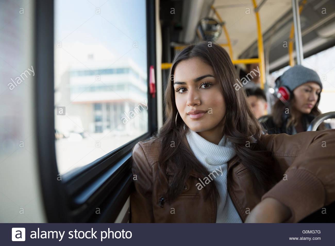 Portrait serious teenage girl riding bus - Stock Image