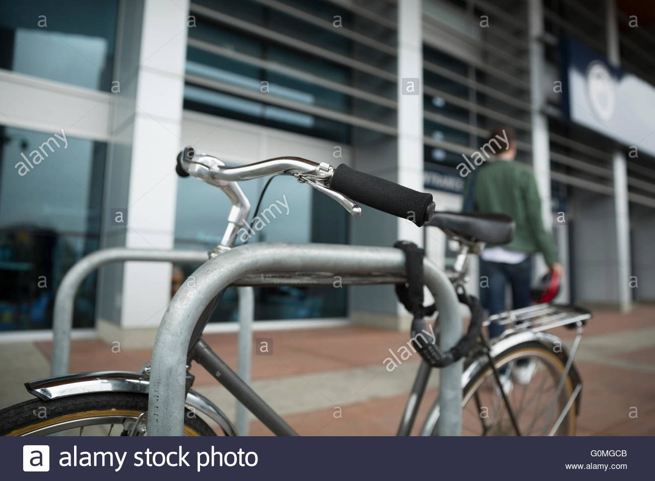 Bicycle secured to post - Stock Image