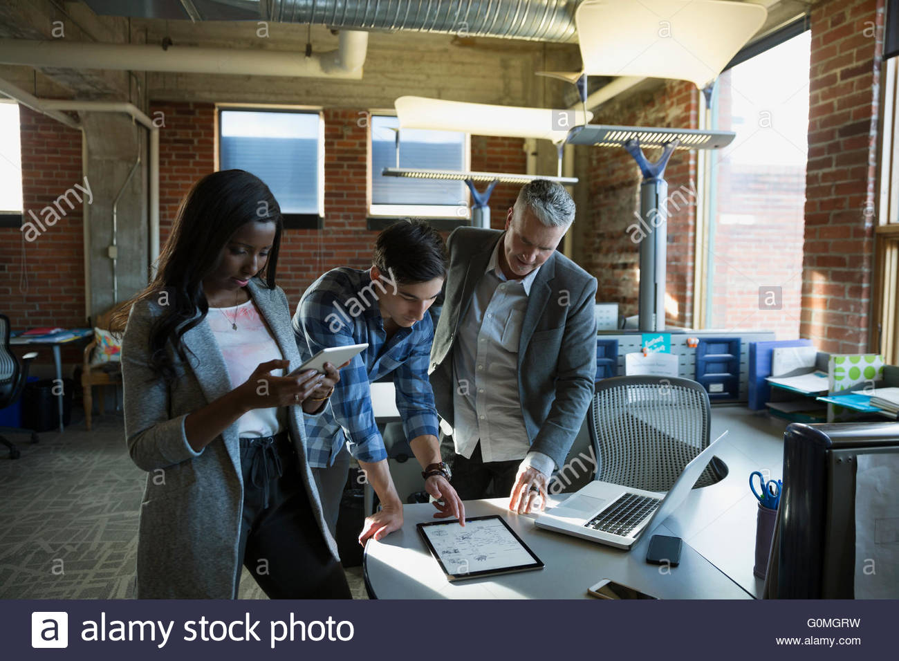 Business people meeting with digital tablets and laptop - Stock Image
