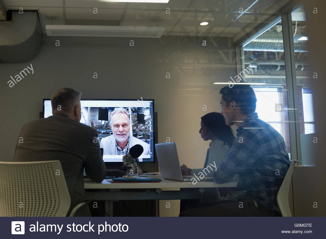 Business people in video conference meeting - Stock Image