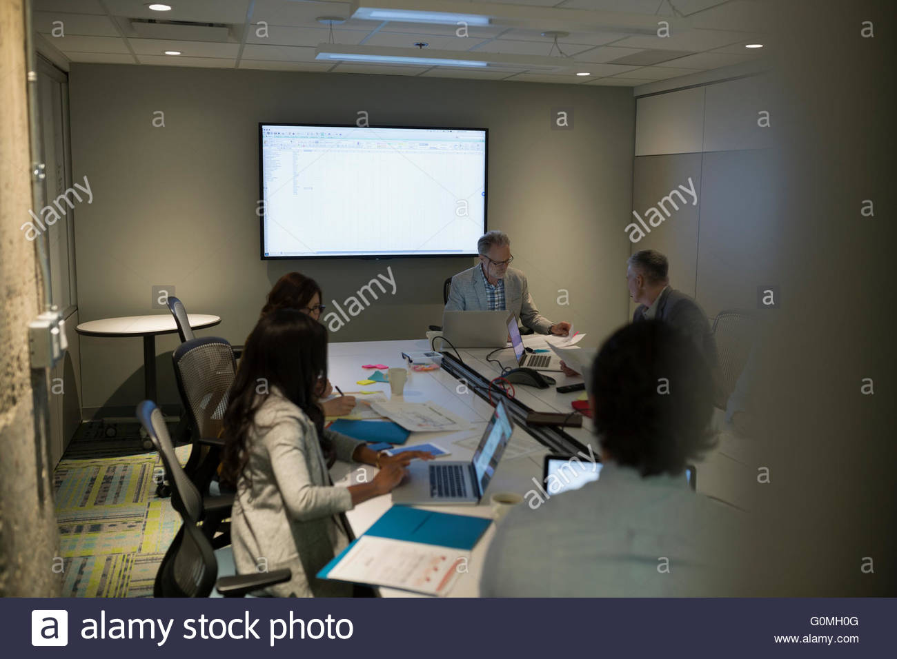 Business people working in conference room meeting - Stock Image