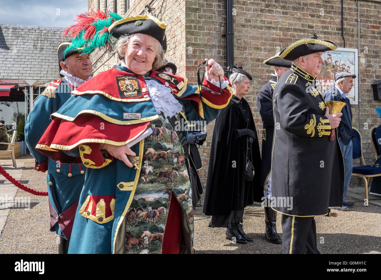 Town crier criers competition at the Ely Eel Festival.  The lovely costumes tri-cornered hat tri corn traditional - Stock Image