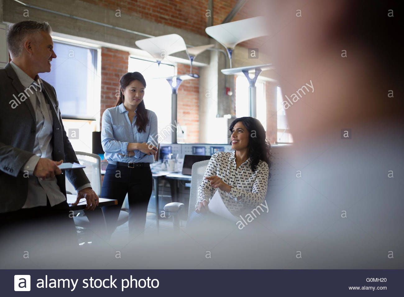 Business people talking in meeting in office - Stock Image