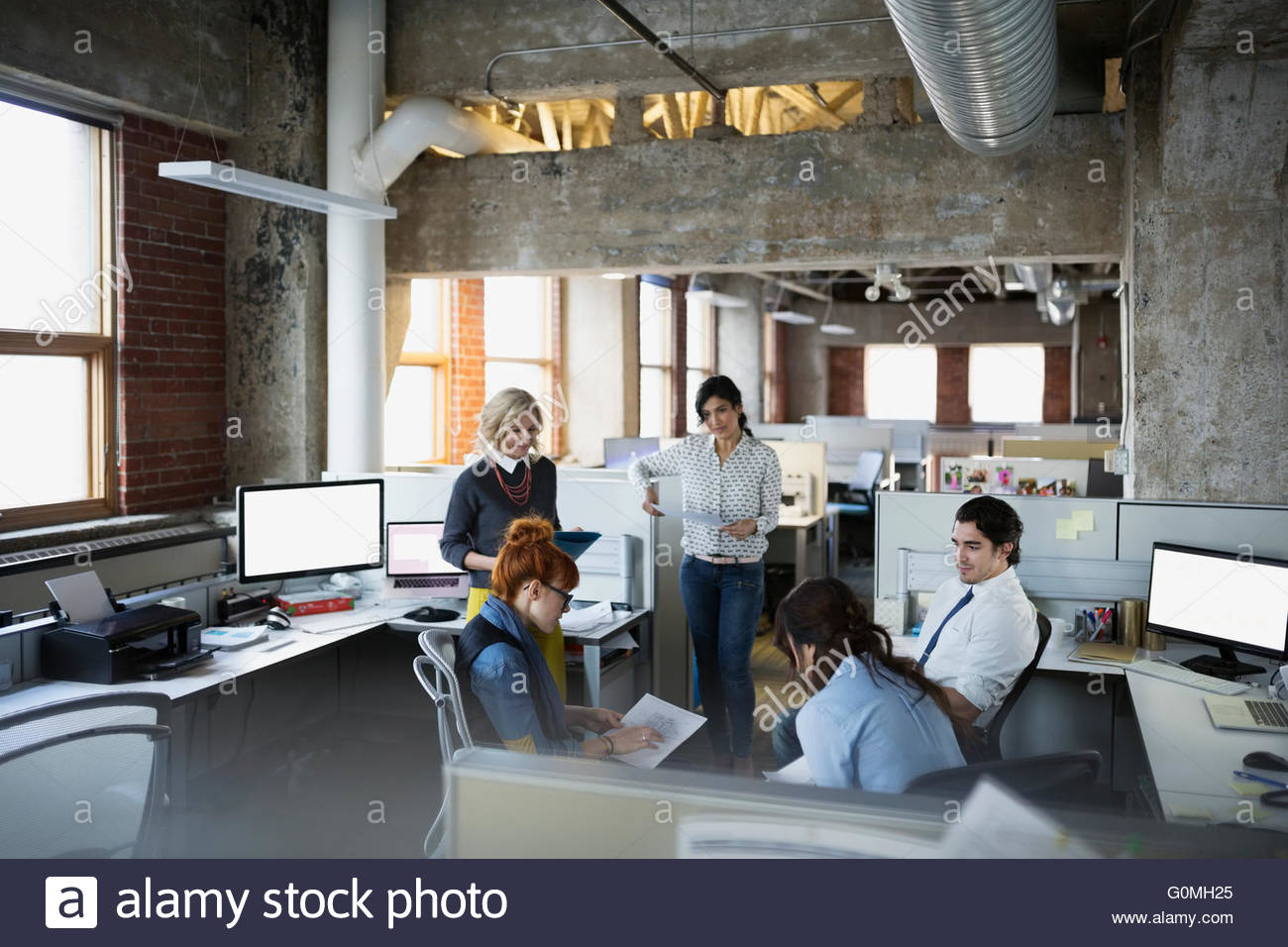Business people meeting in open plan office - Stock Image