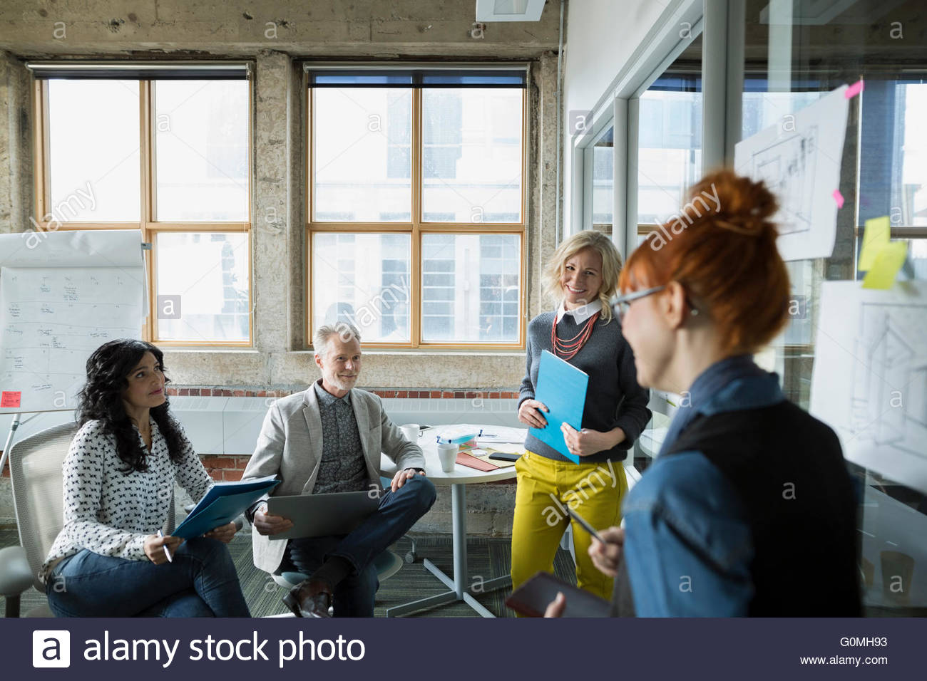 Architects brainstorming in meeting - Stock Image