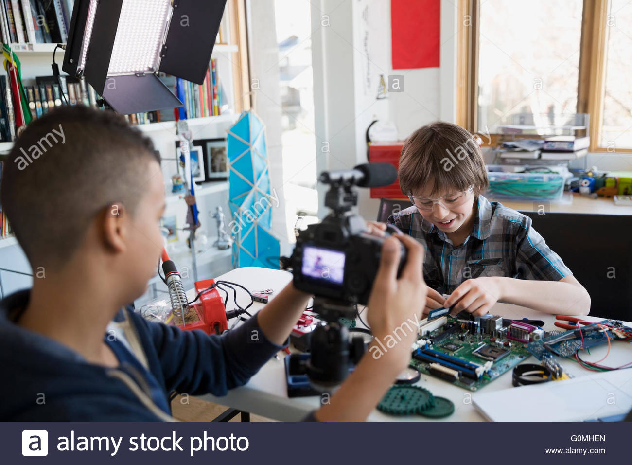 Boys Videotaping Circuit Board Assembly In Bedroom Stock Photo Hobby