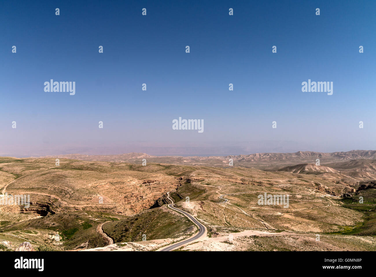 Judean Desert, Palestine. The Kidron Valley (gorge) left, the Dead Sea deep center and the Mar Saba monastery right. - Stock Image