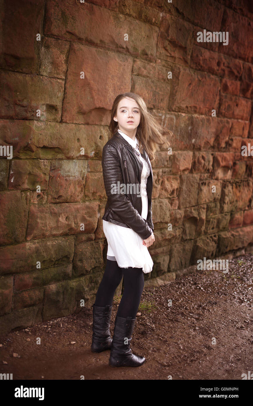 Pretty teenage girl turning around looking into the distance - Stock Image