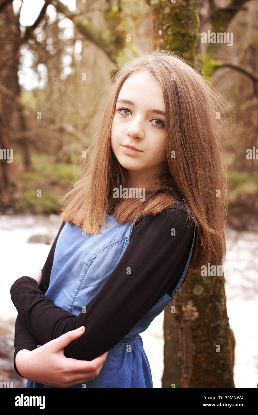 Young Girl Leaning Against Big Tree Trunk — Stock Photo