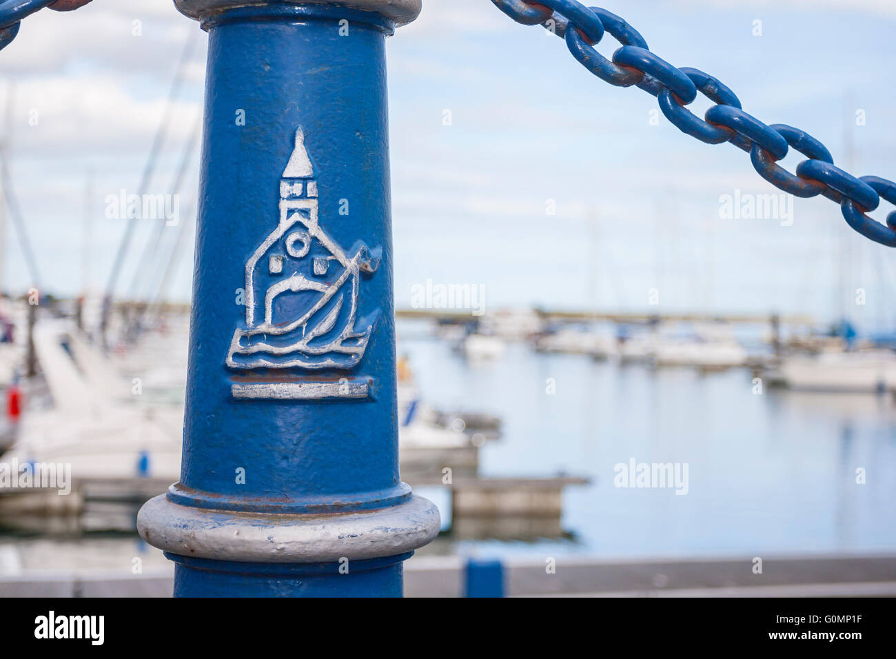 close-up of Detail marina blue pole with malahide port drawing - Stock Image